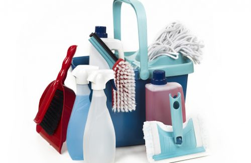 A picture of a spray, brush , soap and other tools used for cleaning